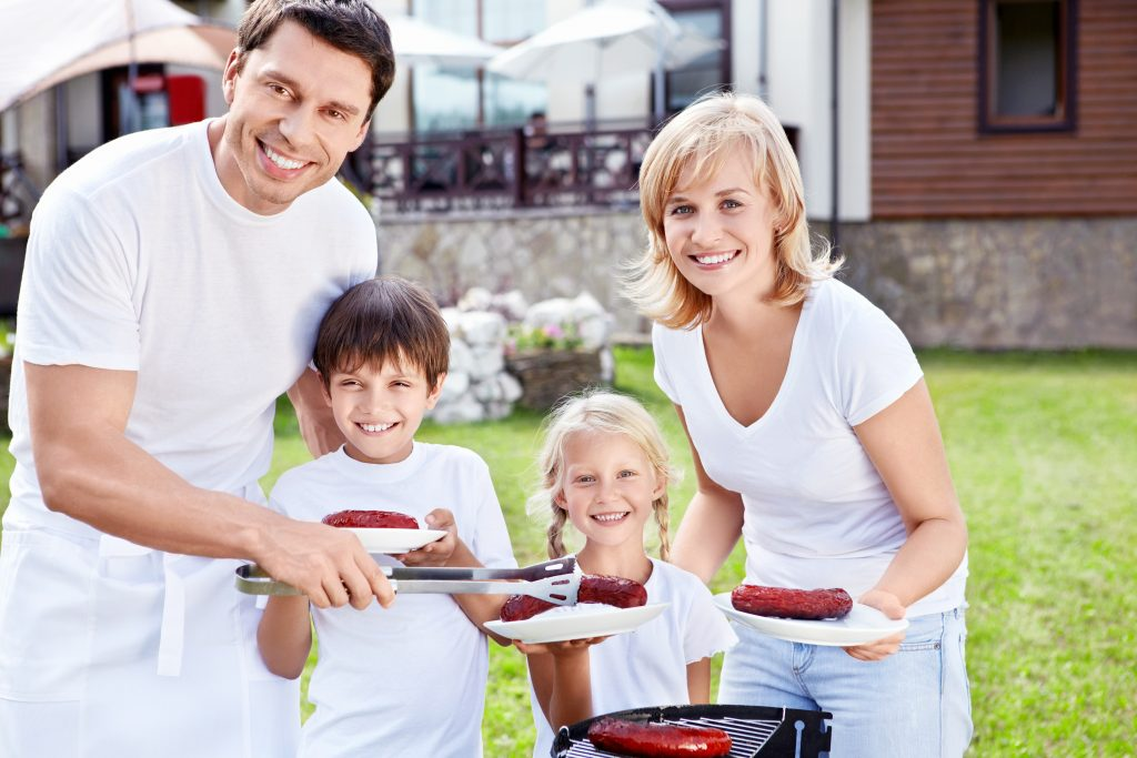 Smiling family with children at barbecue